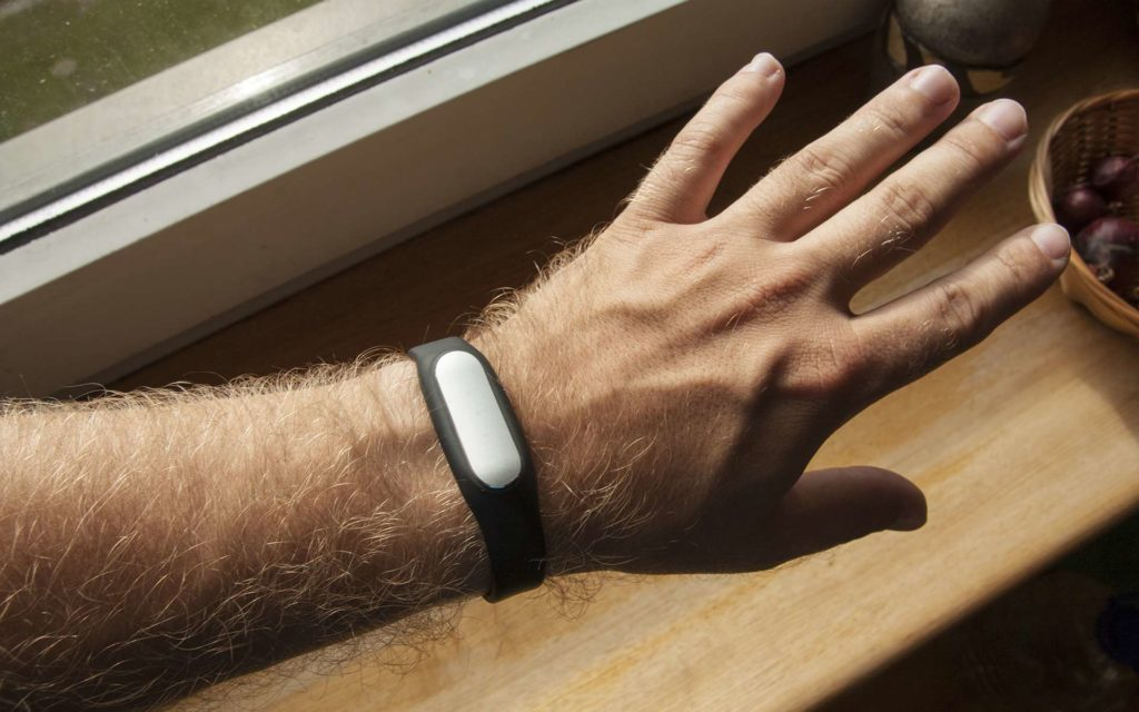 Xiaomi Mi Band on left wrist